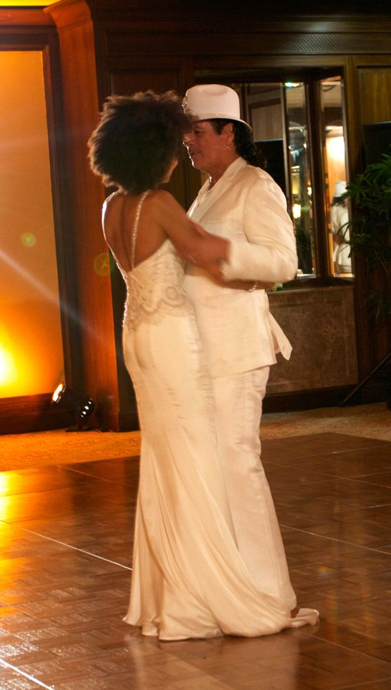 Cindy Blackman and Carlos Santana at their wedding reception Cindys gown was made by hand in