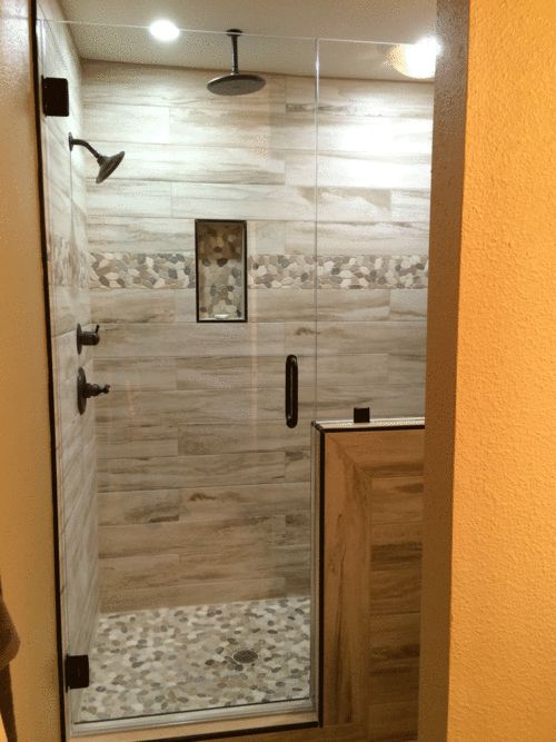 Master Shower with Wood plank tile flat river rock deco