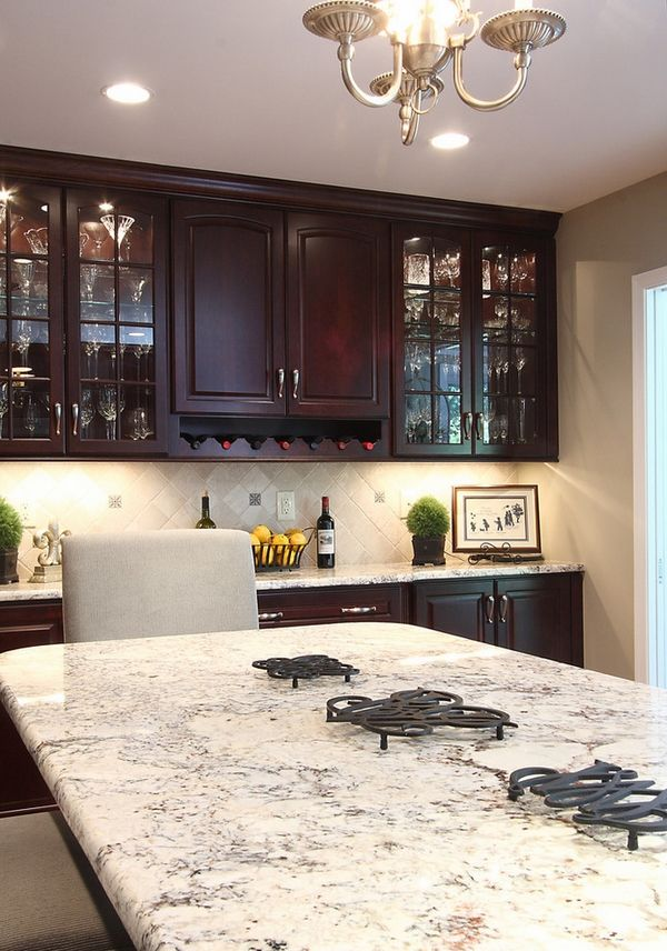 Bianco Romano granite countertops dark kitchen cabinets