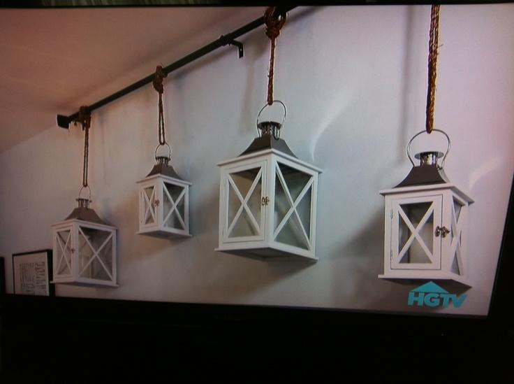 Lanterns hung on curtain rod wall decor  DIY Home Decor