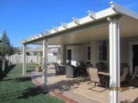 This solid patio cover was installed in the beautiful city ...