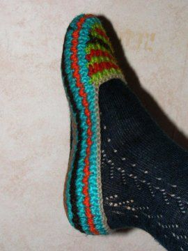 A slipper pattern that says do this till it fits your foot, crochet until it is so many cm tall- use any yarn and matching hook,