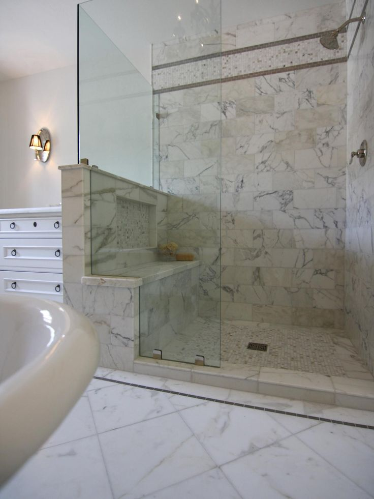 Calacatta Marble Enrobes This Glass Enclosed Shower To