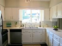 Kitchen:white cabinets, beige countertop, grey/green paint ...