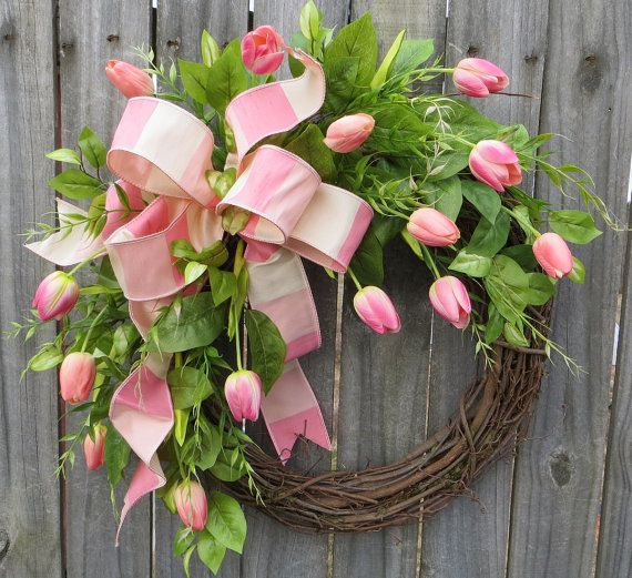 This spring wreath is characterized by the most life-like tulips we have ever seen! We actually stored these tulips in a bucket in