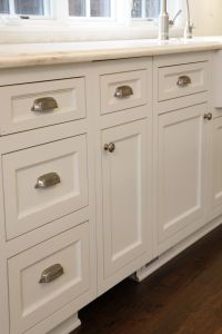 Custom white kitchen cabinets with brushed nickel hardware ...