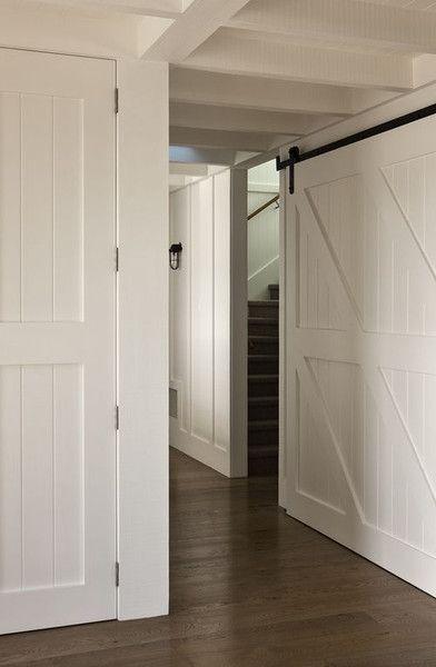 Farmhouse Hallway  White barn doors and dark wood floors
