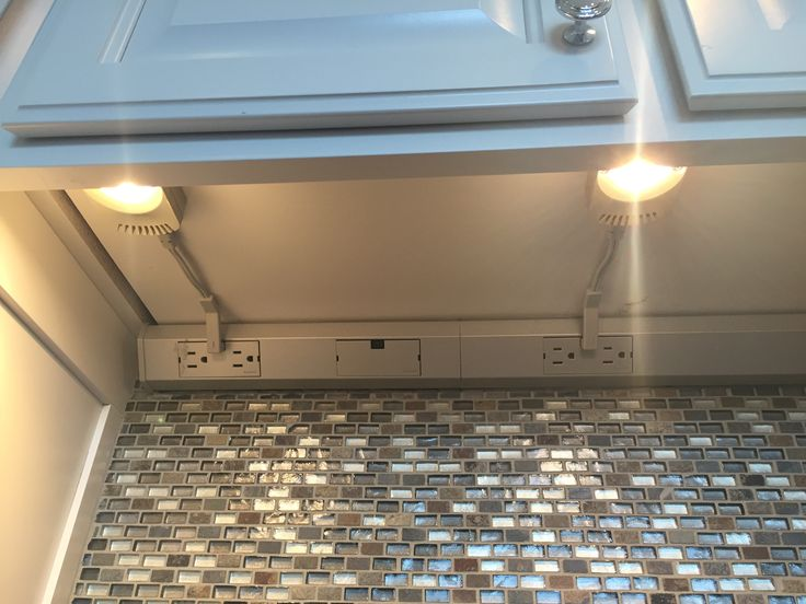 Undercounter lighting with hidden outlet strip so the