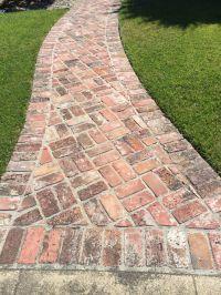Herringbone brick pathway with border on concrete ...