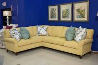 A cool yellow sectional complimented by sea foam green ...
