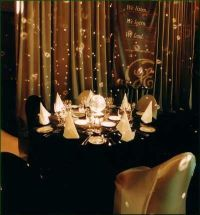 Black table cloths with black and gold chair covers ...