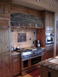 Rustic range hood and stone backsplash | Kitchen ...