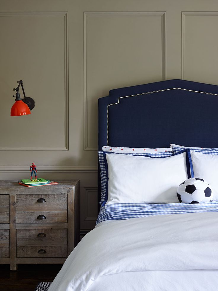 Wall paneling added character to this little boys room and balances the modern elements Navy