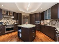 Dark contemporary condo kitchen - center island - vertical ...