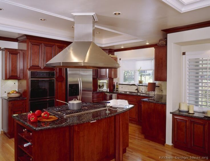 Black Appliances Wood Floor Green Kitchen