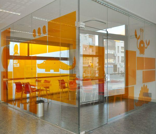 Biblioteca del Sud signage system #signage #glass graphics #orange #window graph