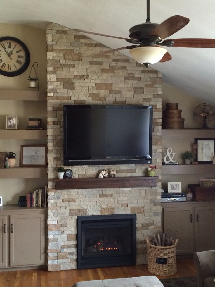 Airstone fireplace with Regency insert and floating shelves for our living room Finally