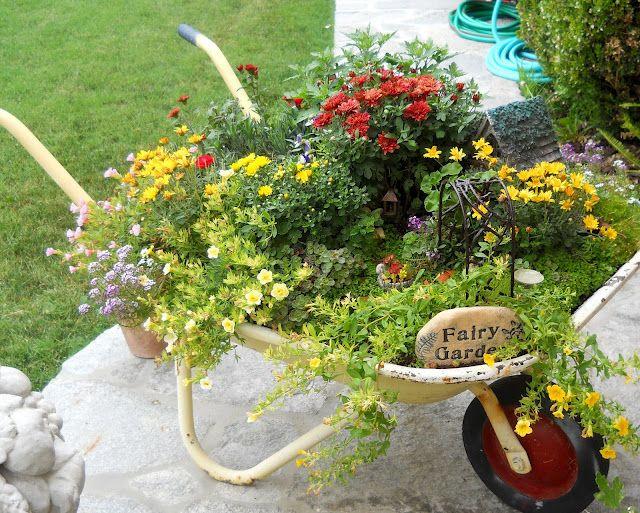 The 25 Best Wheelbarrow Garden Ideas On Pinterest Wheelbarrow