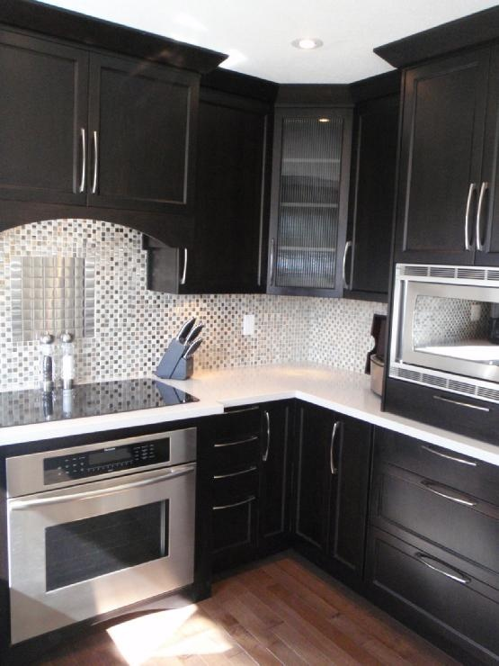 love the black cabinets light counters and glass back