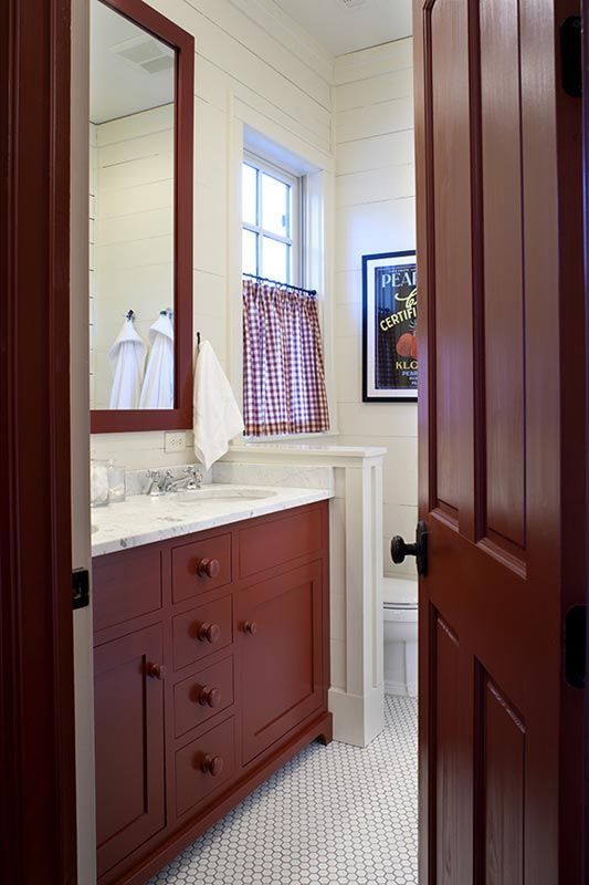 Love this bathroom with cabinets and mirror painted in