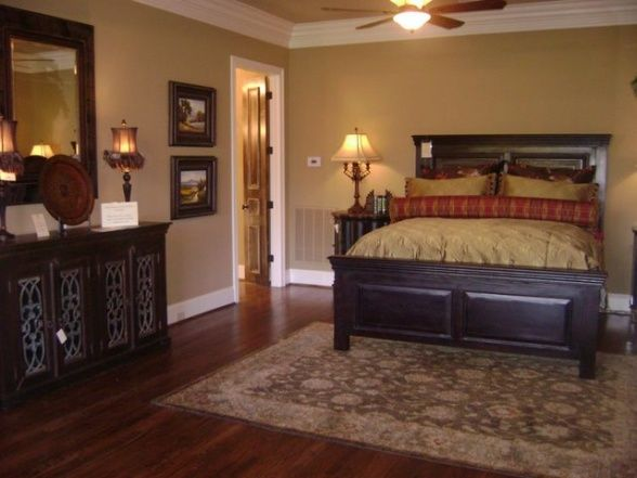 gold bedroom paint colors Dark furniture, gold and red bedding with gold walls and
