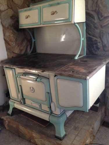 old kitchen sink with drainboard small tables and chairs vintage cast iron wood burning & porcelain stove - one ...