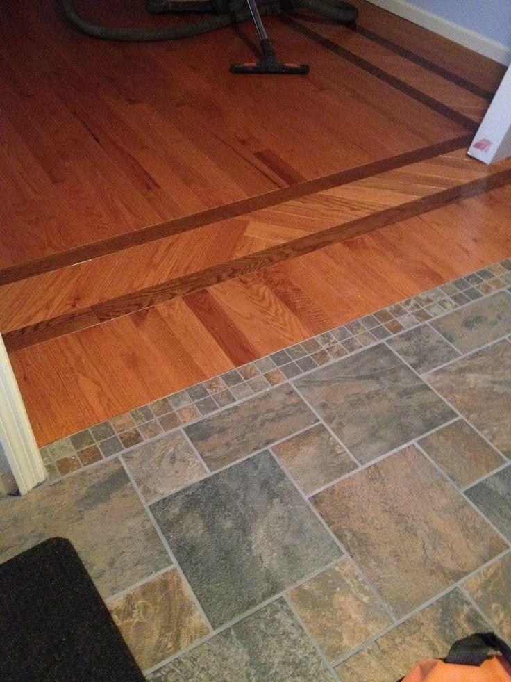 Pinwheel slate floor entryfoyer connected to hardwood