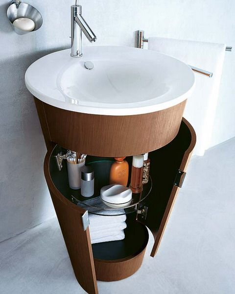 Circular Pedestal Sink With Closed Storage Underneath For