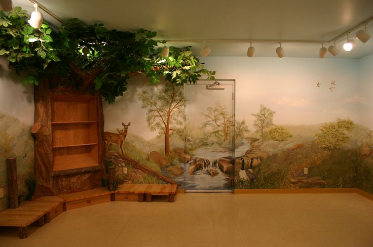 Childrens library with hand painted mural and Tree