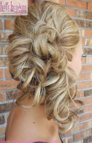 curls pinned side. side ponytail