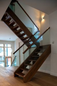 Walnut freestanding stairs with open risers and glass ...