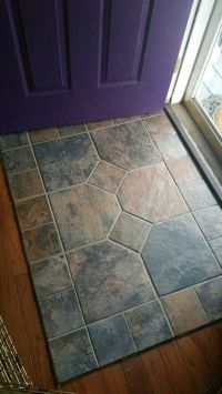 Slate entry.. porcelain tile that looks like wood going to ...