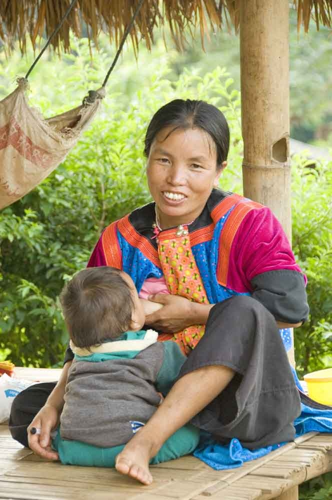 lisu mother breast feeding her baby in a hill tribes
