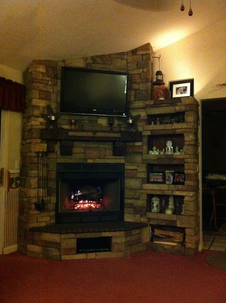 Corner wood burning fireplace with built in shelves Mantle is 6x6 oak timber that was shaped