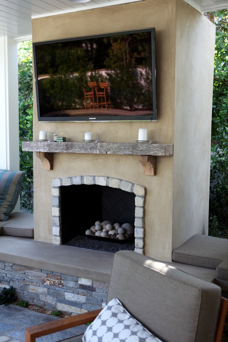 Smooth Stucco Fireplace with Lompoc Cobblestone and a Reclaimed Wood Mantle  DIG Fireplaces