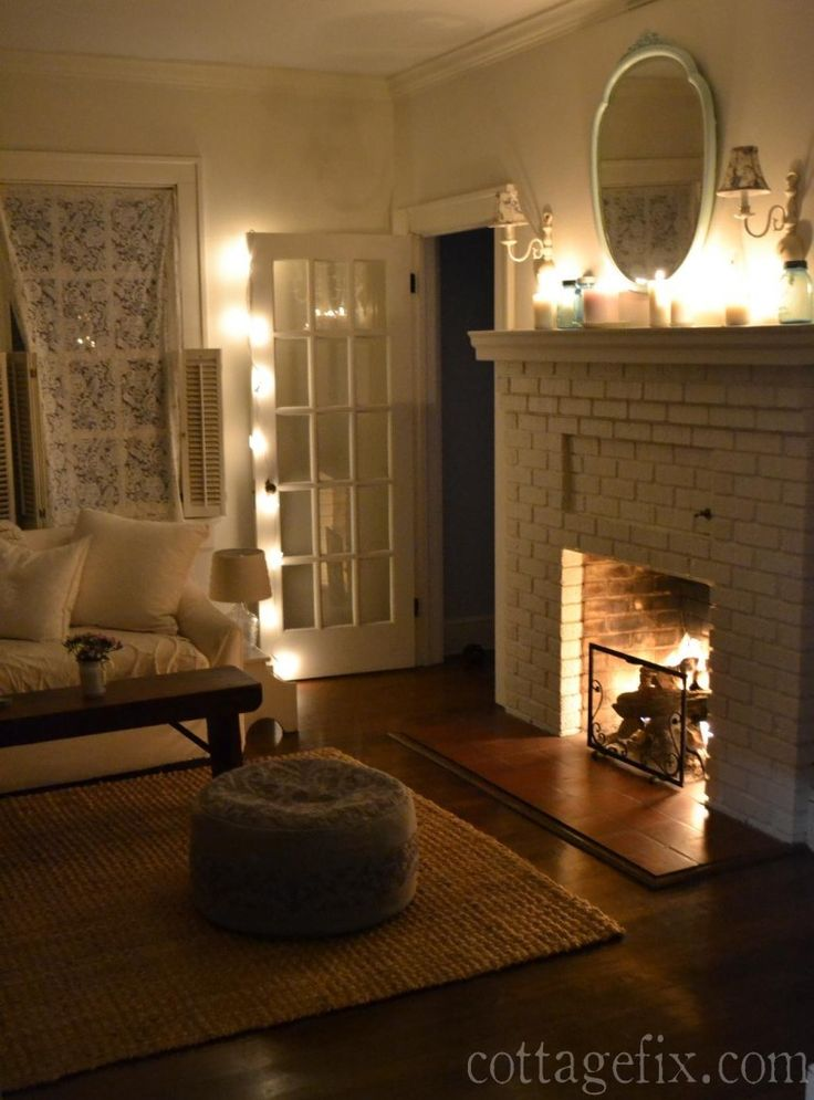 Cottage Fix blog  living room with white candles twinkle lights and a cozy  String Lights