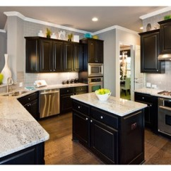 Hardwood Kitchen Floor Hanging Light Fixtures For Black Cabinets And Gray Subway Tile Tied Together By ...