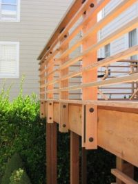 Horizontal wood railing, I like the exposed hardware, the