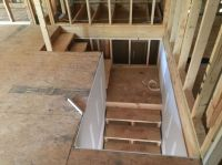Looking down stairs from unfinished bonus room above ...