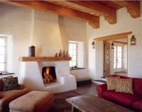 Pretty interior of a cob home. I love the fireplace and ...