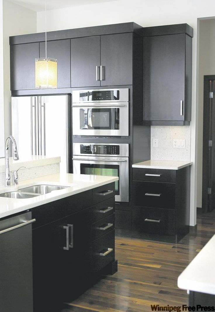 Dark expresso cabinets topped with white quartz