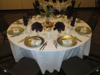 Eggplant napkins, white tablecloth and gold charger plate ...