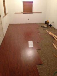 laying laminate flooring over carpet | TheFloors.Co