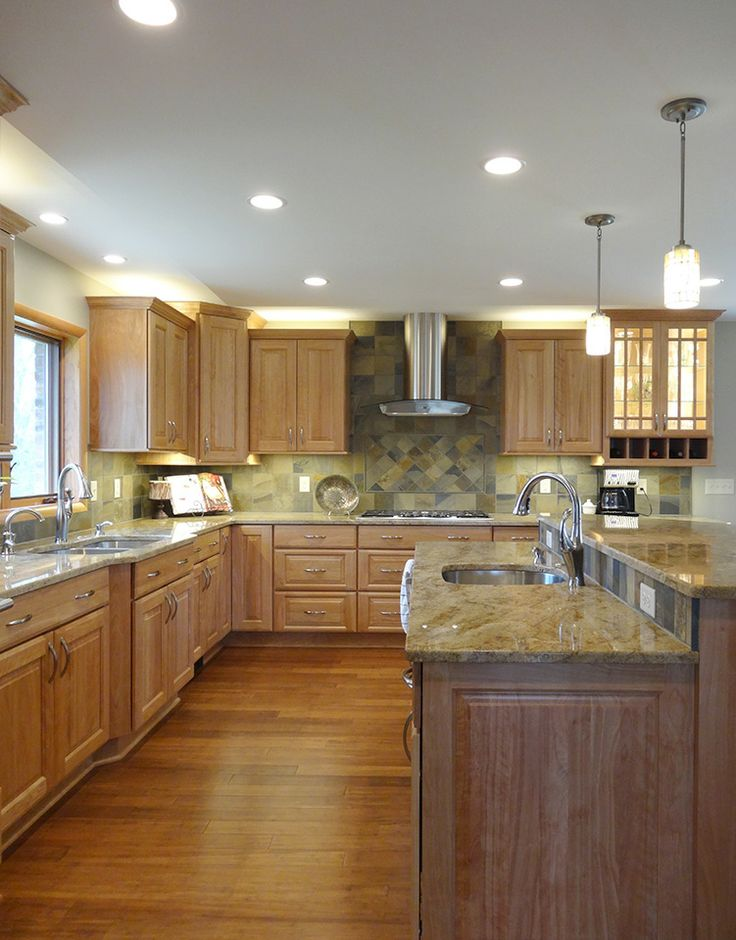 rustic hickory kitchen cabinets country range hoods this saline remodel features red birch ...