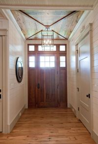 Foyer. Foyer with custom door, wood ceiling and tongue and ...