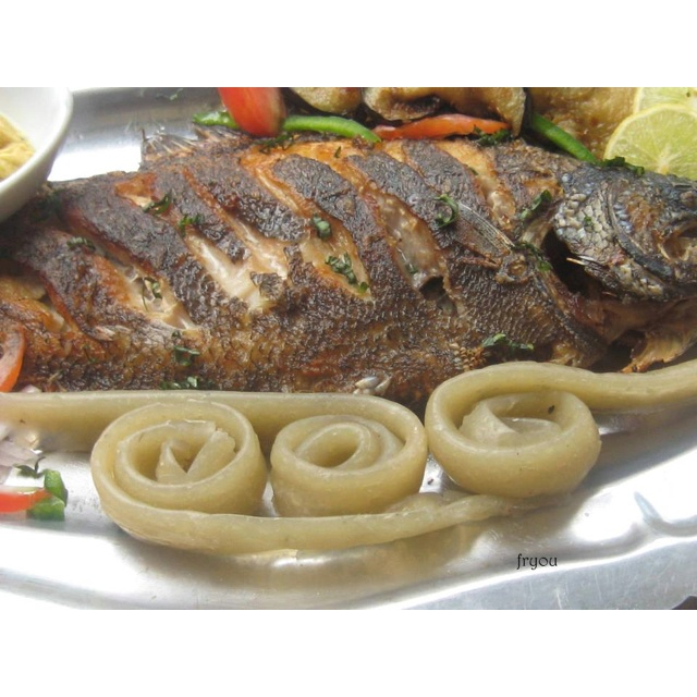 Cameroonian Cuisine Grilled fish served with Miondo  Dam  Pinterest  Grilled fish Cuisine