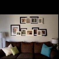 Wedding pics on ledge above couch. I love Ikea ...