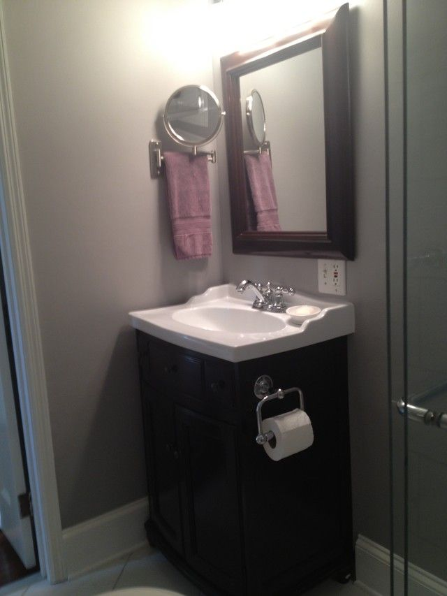 Toilet paper holder on side of vanityTiny Bathroom