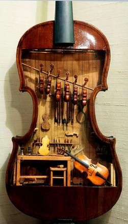 This 18th-century violin makers shop by W. Foster Tracy, 1979, is a miniature built inside a full-size violin. It was on display