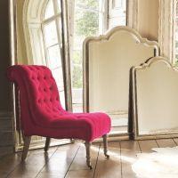 Bright pink velvet nursing chair from Graham and Green ...